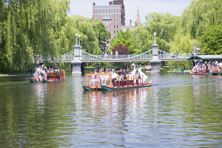 boston common: Swan Boat with tourists goes by Suspension Bridge in Public Garden and Boston Common in summer, Boston, Ma., New England, USA Editorial