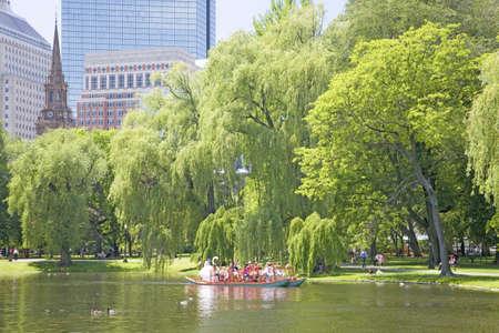boston common: Swan Boat with tourists in Public Garden and Boston Common in summer, Boston, Ma., New England, USA