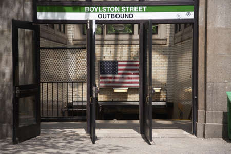 outbound: Boylston Street Outbound Subway Train with American Flag displayed, Boston MA