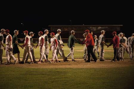 shakes hands: Nashoba Chieftans high school baseball team shakes hands with winning team, western MA, outside of Boston