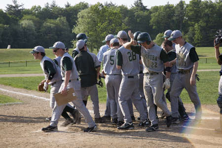 baseball caps: Nashoba Chieftans high school baseball team breaks before playing Shrewsbury Colonials , Shrewsbury, MA, 52711