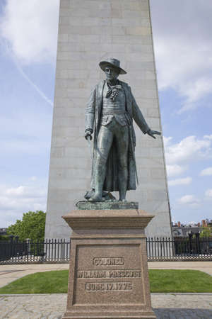 american revolution: Statue of Colonel Wiliam Prescott stands in front of Bunker Hill Memorial. It stands 221 feet tall at Breeds Hill, the site of the first major battle of the American Revolution, June 17, 1775, Boston, MA