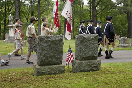 Historic Lexington Cemetery on Memorial Day, 2011 where Boy Scouts and Revolutionary soldiers honor fallen soldiers, MA