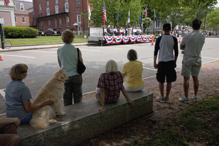 Crowd with dog watches veterans ceremony on Memorial Day, 2011, Concord, MA