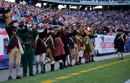 Reenactment of Patriots firing rifles after New England Patriots score at the Gillette Stadium Editorial