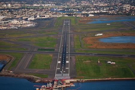 outskirts: Airplane runway in the outskirts of town  Stock Photo