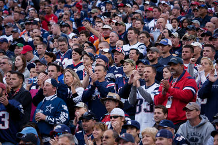Gillette Stadium, Foxborough, MA - October 16, 2011 - New England Patriots supporters focused on the game  新聞圖片