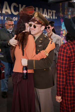 A man and woman dressed up in 1940s attire hugging during  Pearl Harbor Day World War II Troop Train re-enactment from Los Angeles Union Station to San Diego