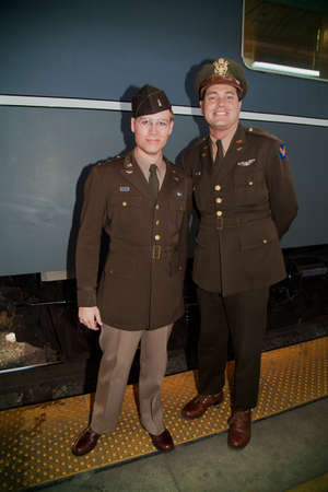 troop: Two men dressed up in 1940s uniform posing before boarding the Pearl Harbor Day Troop Train re-enactment from Los Angeles Union Station to San Diego