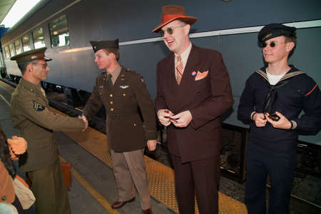 Reenactors dressed in 1940s attire bidding farewell before departing on Pearl Harbor Day Troop Train re-enactment from Los Angeles Union Station to San Diego