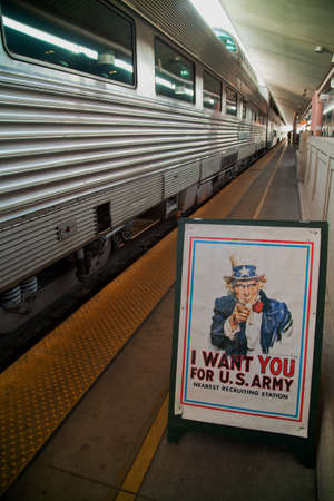 sam: A poster of Uncle Sam I Want You for US Army in front of Pearl Harbor Day Troop Train re-enactment from Los Angeles Union Station to San Diego Editorial