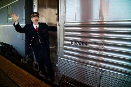 Train conductor says All Aboard on the Pearl Harbor Day Troop 1940s Train e-enactment from Los Angeles Union Station to San Diego  Editorial