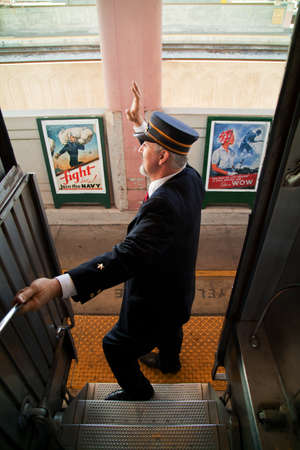 aboard: Train conductor says All Aboard on the Pearl Harbor Day Troop 1940s Train e-enactment from Los Angeles Union Station to San Diego