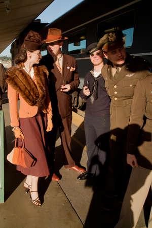 historic world event: Reenactors dressed in 1940s attire standing in front of the Pearl Harbor Day World War II Troop Train, Los Angeles to San Diego