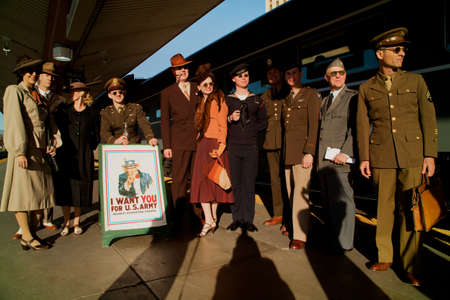uniform attire: Reenactors dressed in 1940s attire standing in front of the Pearl Harbor Day World War II Troop Train, Los Angeles to San Diego