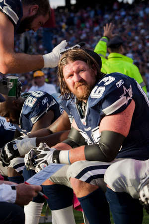 kyle: Kyle Bain Kosier, guard tackle #63 of Dallas Cowboys sitting on a bench in Gillette Stadium during the match between New England Patriots and Dallas Cowboys