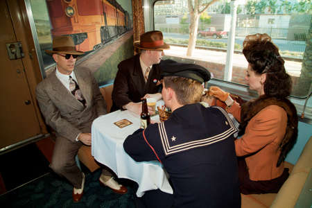 Reenactors dressed in 1940s attire on Pearl Harbor Day Troop Train re-enactment from Los Angeles Union Station to San Diego