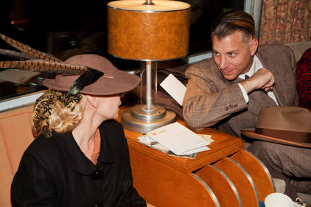 troop: A woman and man dressed up in 1940s attire on Pearl Harbor Day Troop Train re-enactment from Los Angeles Union Station to San Diego