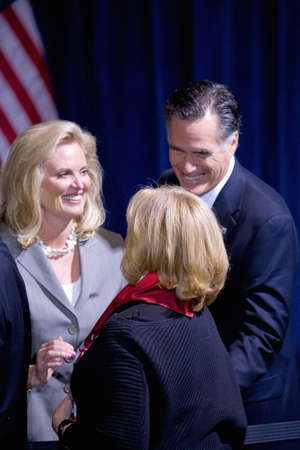 endorsing: Trump International Hotel, Las Vegas, Nevada - February 2, 2012 - Mitt Romney and his wife, Ann Romney interacting with unidentified person Editorial