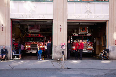 North End, Boston, MA - May 11, 2012 - People standing in Ladder No 1 & Engine No 8 fire station