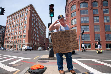 veterans: Vietnam War Veteran with written placard saluting