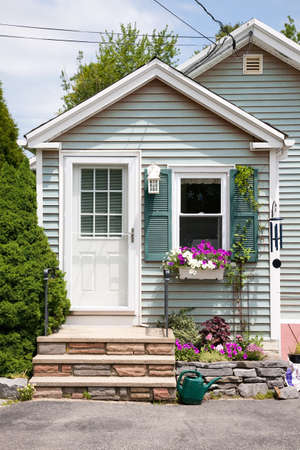 front of: Detached house with flowers on front porch in Maine