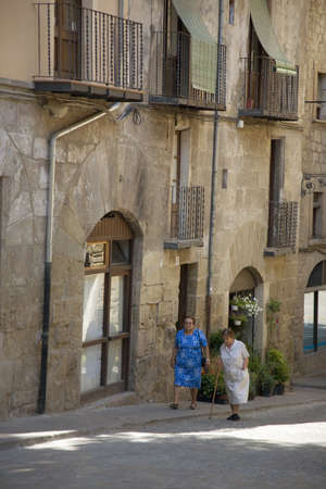 spaniards: Two older women walking in village of Solsona, Cataluna, Spain