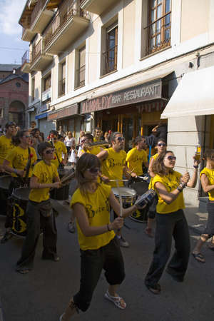 spaniards: Marching band making their way down the streets of Puigcerda, Girona, Cataluna, Spain, Europe