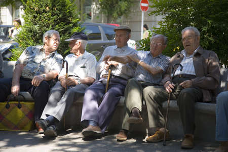 spaniards: Men on Saturday afternoon sitting on park bench in La Seu dUrgell, (Sa Seu dUrgell) in Catalunya, Spain