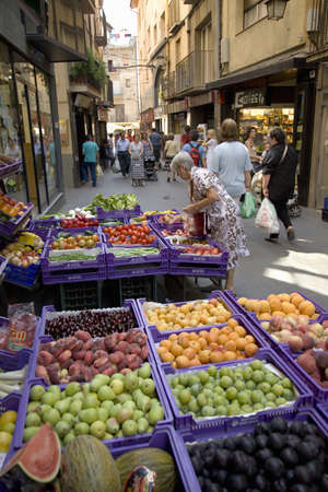 Woman shopping in central market of La Seu dUrgell, (Sa Seu dUrgell) in Catalunya, Spain Editorial