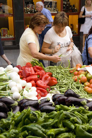 Women shopping for vegetables in Central Market of La Seu dUrgell, (Sa Seu dUrgell) in Catalunya, Spain Editorial