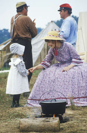 Young participants in Civil War costume in camp scene during reenactment of Battle of Manassas, Virginia Editorial