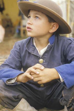 participant: Portrait of young Civil War participant in camp scene during recreation of Battle of Manassas, Virginia