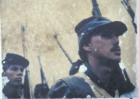 Polaroid Transfer of soldiers marching into war during Civil War reenactment of Battle of Bull Run