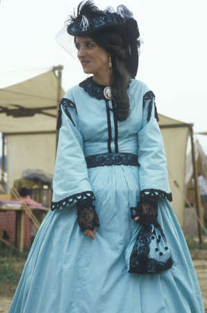 Female Participant in full dress costume during reenactment of Battle of Manassas, Virginia