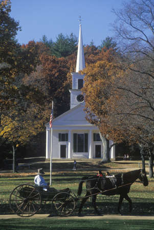 horse drawn carriage: Horse drawn carriage outside of steeple church in Old Sturbridge, Historical town in MA Editorial