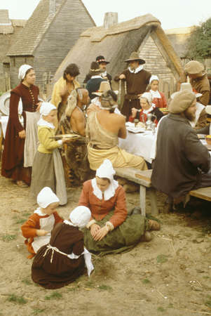 Living history reenactment of Pilgrims and Indians dining on Plymouth Plantation, Plymouth, MA
