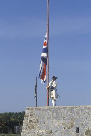 Historical reenactment of raising of flag at Fort Ticonderoga, site of French and Indian Wars, Lake Champlain, NY