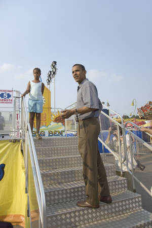 campaigning: U.S. Senator Barak Obama campaigning for President with his daughter at Iowa State Fair in Des Moines Iowa, August 16, 2007