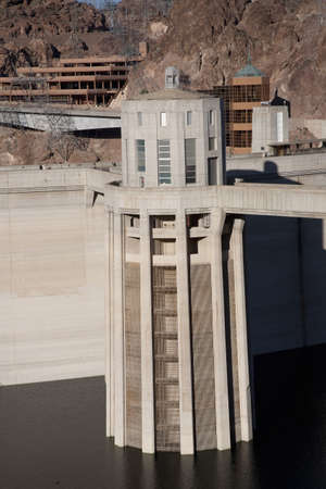 bordering: Hoover Dam in the Black Canyon of the Colorado River, bordering Arizona and Nevada Stock Photo