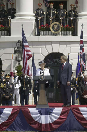 Queen Elizabeth II speaking with President George W. Bush to her left during the National Anthem on the South Lawn of the White House for the May 7, 2007 Official State Welcoming of Her Majesty Queen Elizabeth II and Prince Philip, the Duke of Edinburgh t