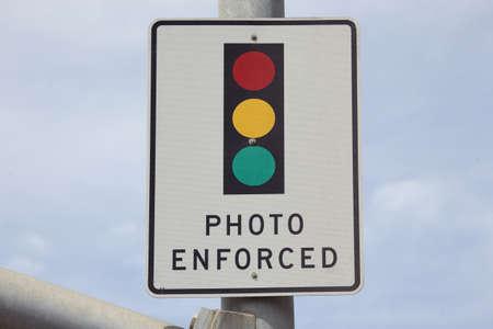 summons: Photo Enforced signage above traffic light