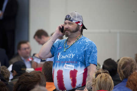 A Mitt Romney supporter on a phone call during a rally