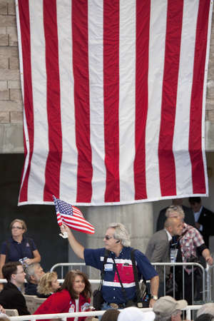 A supporter of Mitt Romney waving the flag of the United States of America at a rally during the 2012 Presidential Election