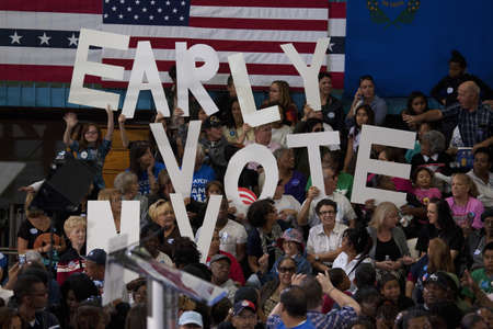 Crowd holding Vote Early sign at a Presidential Campaign rally during the 2012 Presidential Election