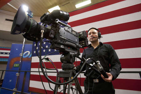 Videographer at a Presidential Campaign rally during the 2012 Presidential Election