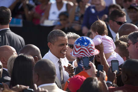senator: 2012 Democrat Presidential Candidate, Senator Barack Obama flanked by people at a Presidential Campaign rally