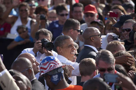 2012 Democrat Presidential Candidate, Senator Barack Obama flanked by people at a Presidential Campaign rally