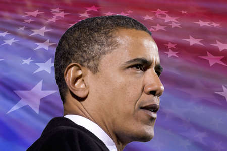 President Barack Obama against a backdrop of the flag of the United States of America