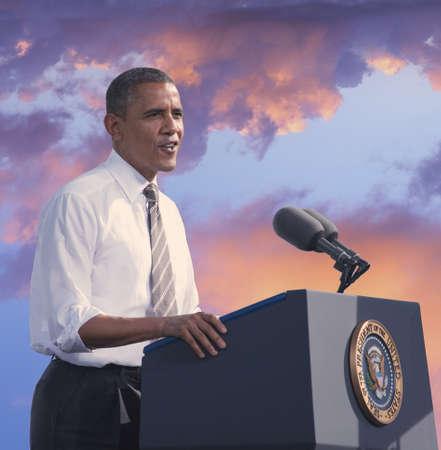 President Barack Obama speaking against a backdrop of a sunset Zdjęcie Seryjne - 23059147